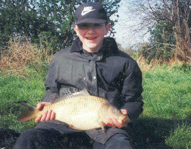 A young Mike Linstead with an 8lb Common Carp (1997)