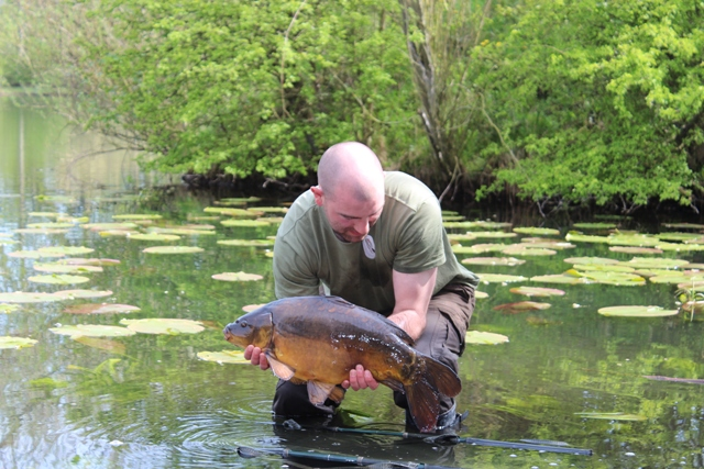 Mike Linstead with a surface caught mirror carp