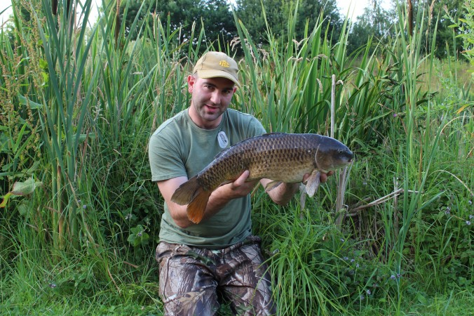 Mike Linstead with a Common Carp from Pool Bridge Farm