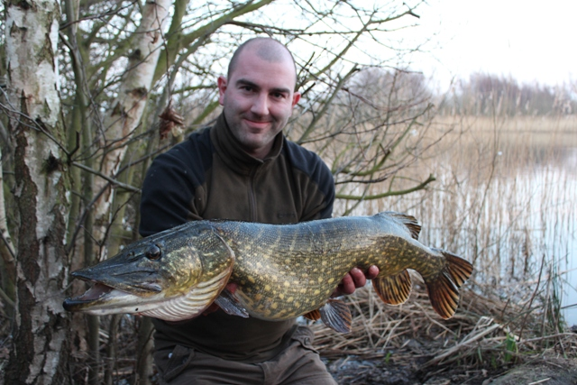 Mike Linstead with a 14lb 9oz Pike from an undisclosed water