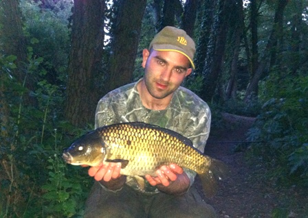 Mike Linstead with a common carp from Conifer Lake, East Yorkshire