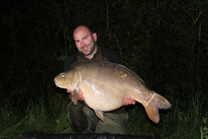 Mike Linstead with a 43lb 8oz Blue Lake Mirror Carp