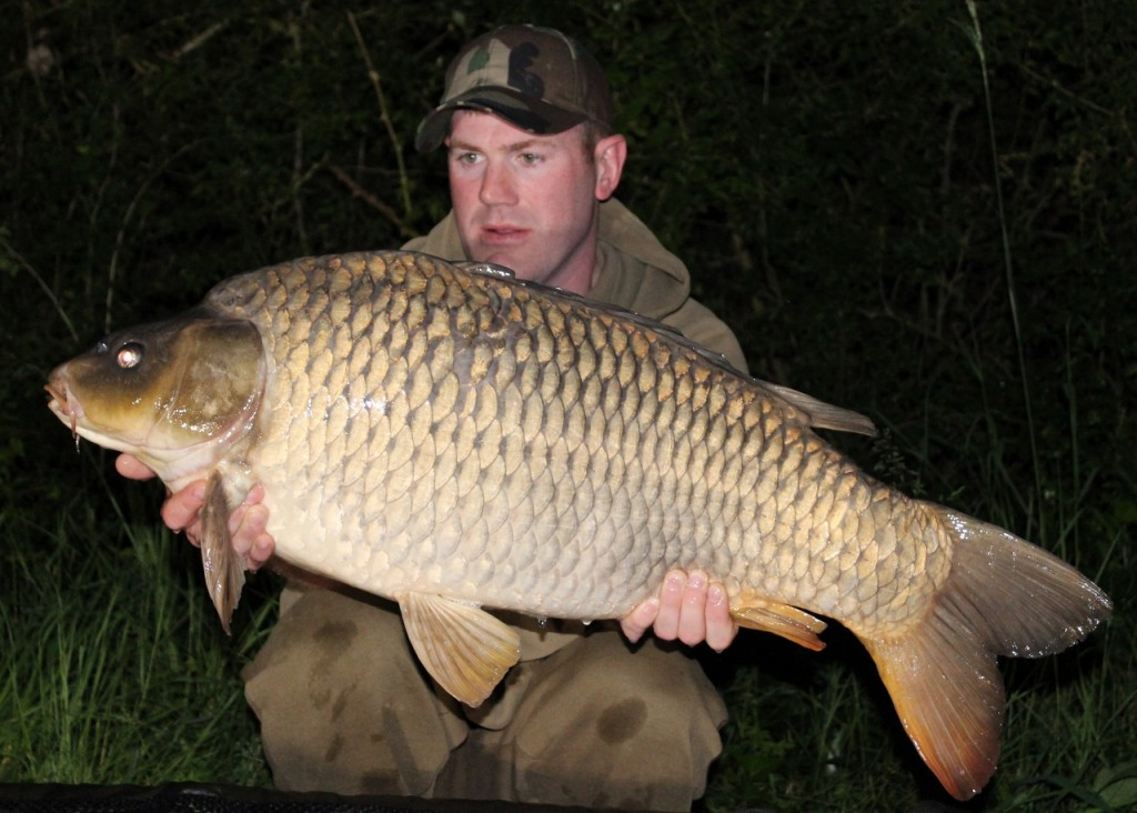 Matt Linstead with a 34lb Blue Lake Common Carp