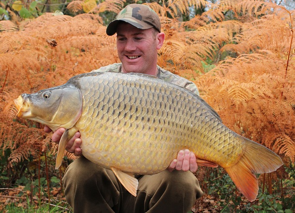 Matt with a stunning common carp against an equally stunning backdrop