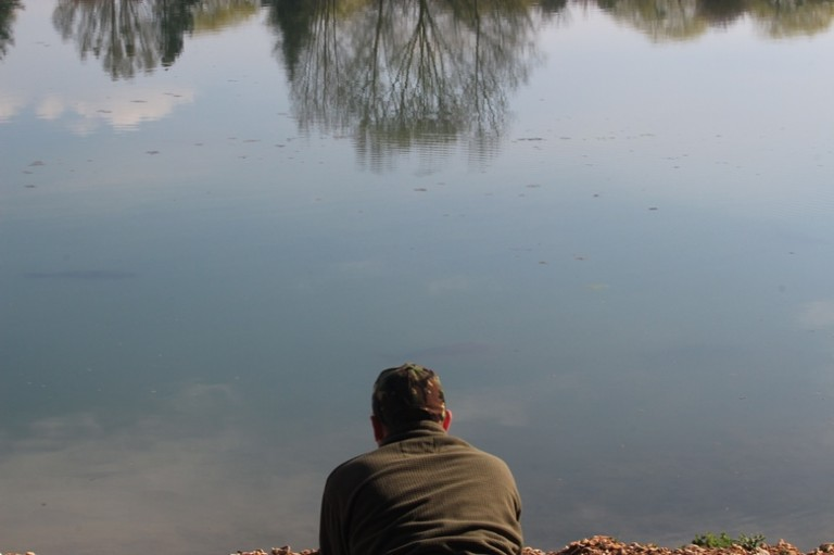 Matt observing carp at close quarters at Deux Iles